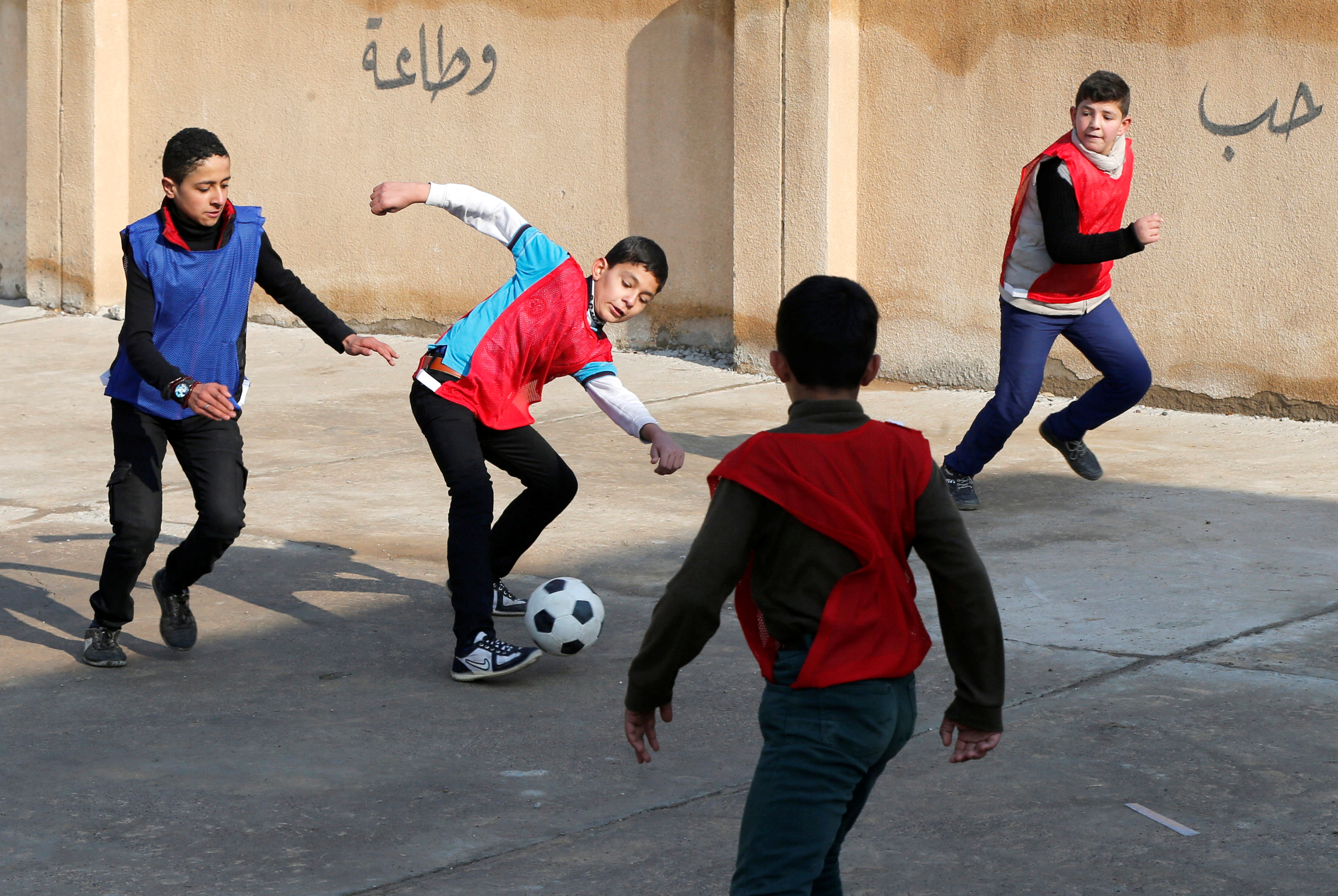 Children played soccer in Mosul as the city gradually returned to normal. Photo by Muhammad Hamed/Reuters