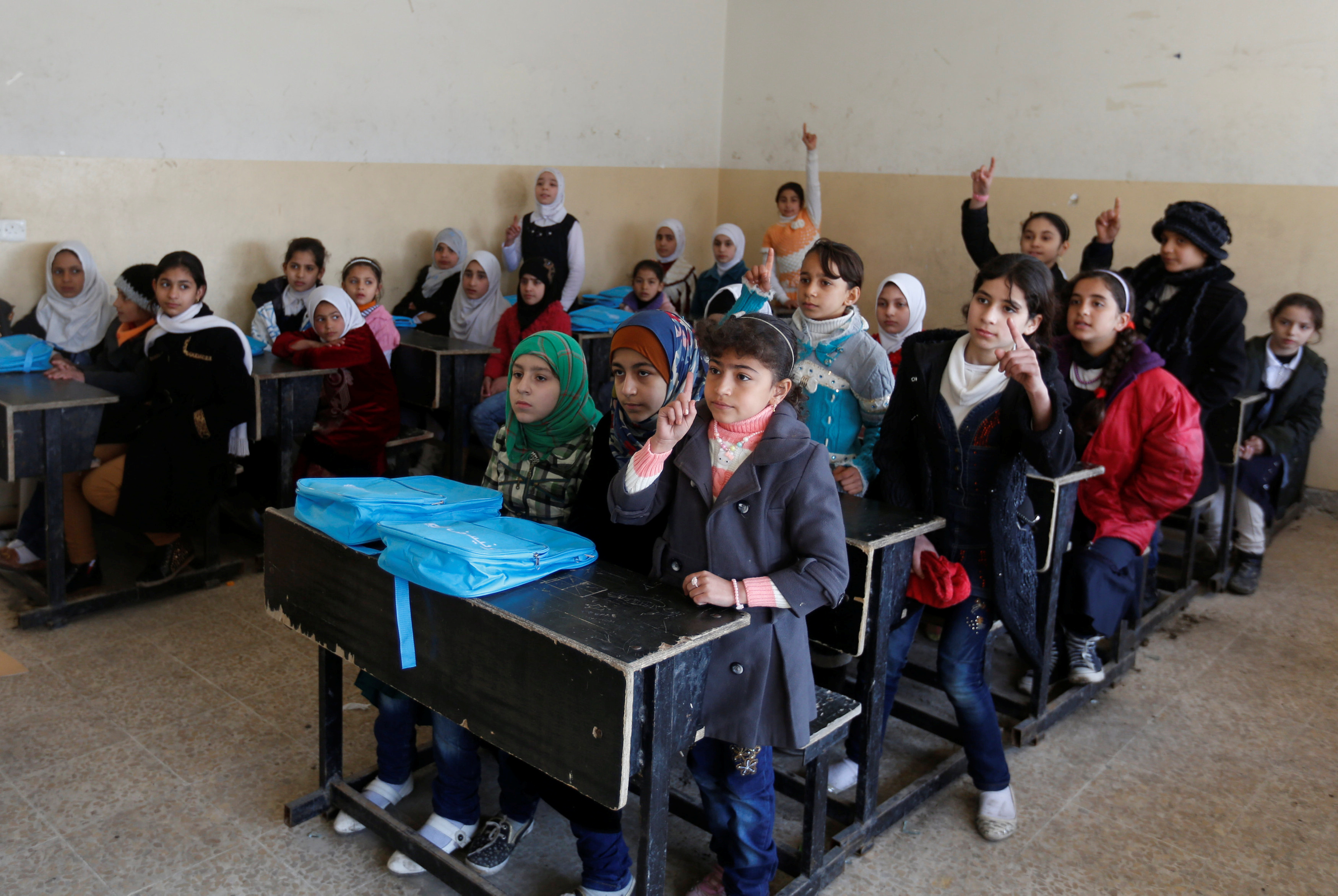 About 30 schools opened in eastern Mosul after Iraqi forces took back control from the Islamic State group. Photo by Muhammad Hamed/Reuters