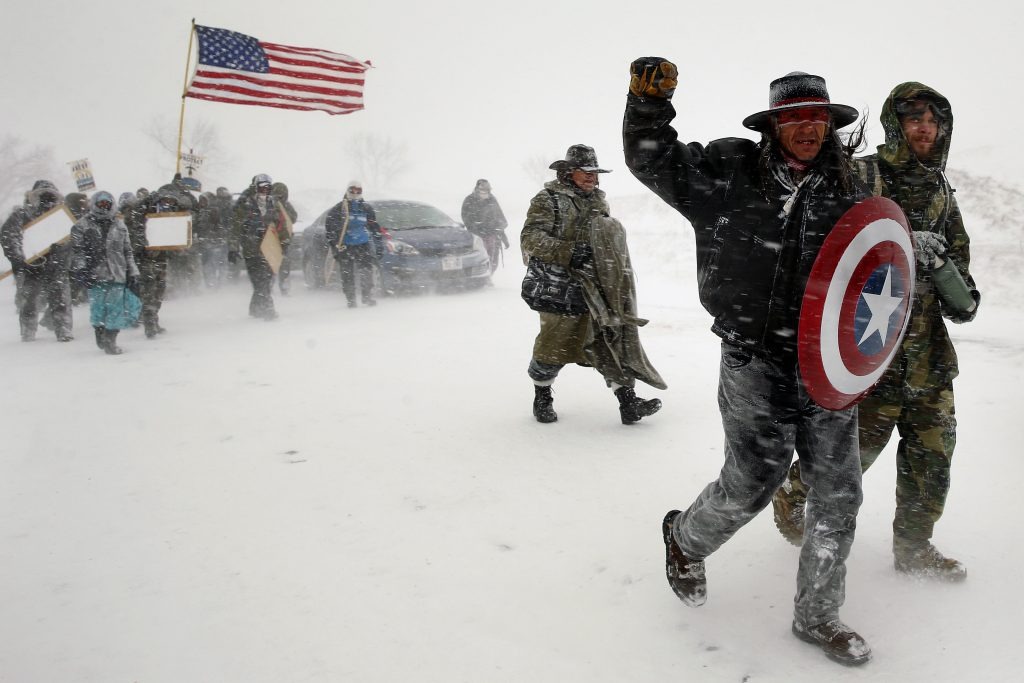 "Veterans join activists in a march to Backwater Bridge just outside the Oceti Sakowin camp during a snow fall as ""water protectors"" continue to demonstrate against plans to pass the Dakota Access pipeline adjacent to the Standing Rock Indian Reservation, near Cannon Ball, North Dakota, U.S., December 5, 2016.  REUTERS/Lucas Jackson/File Photo"