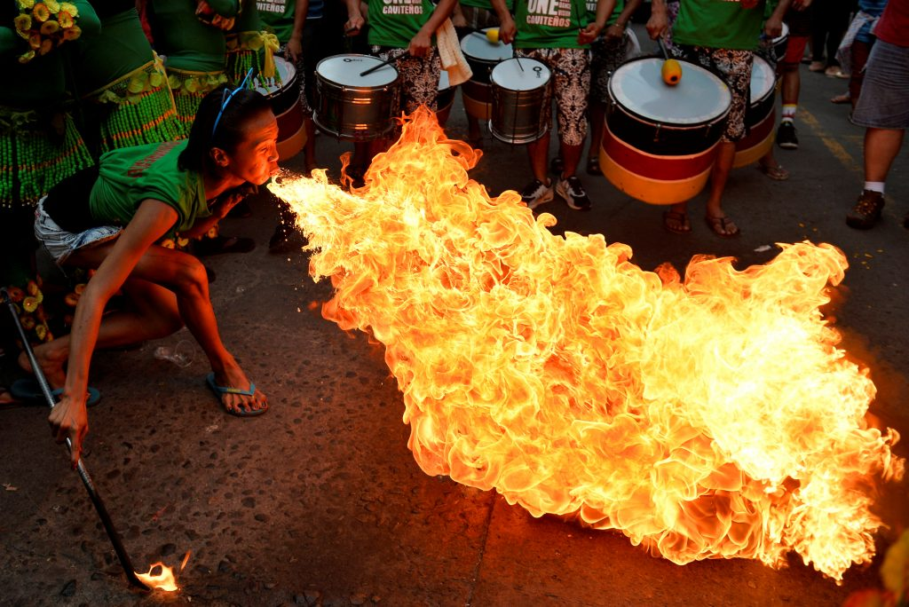 A reveller blows fire during Chinese Lunar New Year celebrations Jan. 28 in Manila's Chinatown, Philippines. Photo by: Ezra Acayan