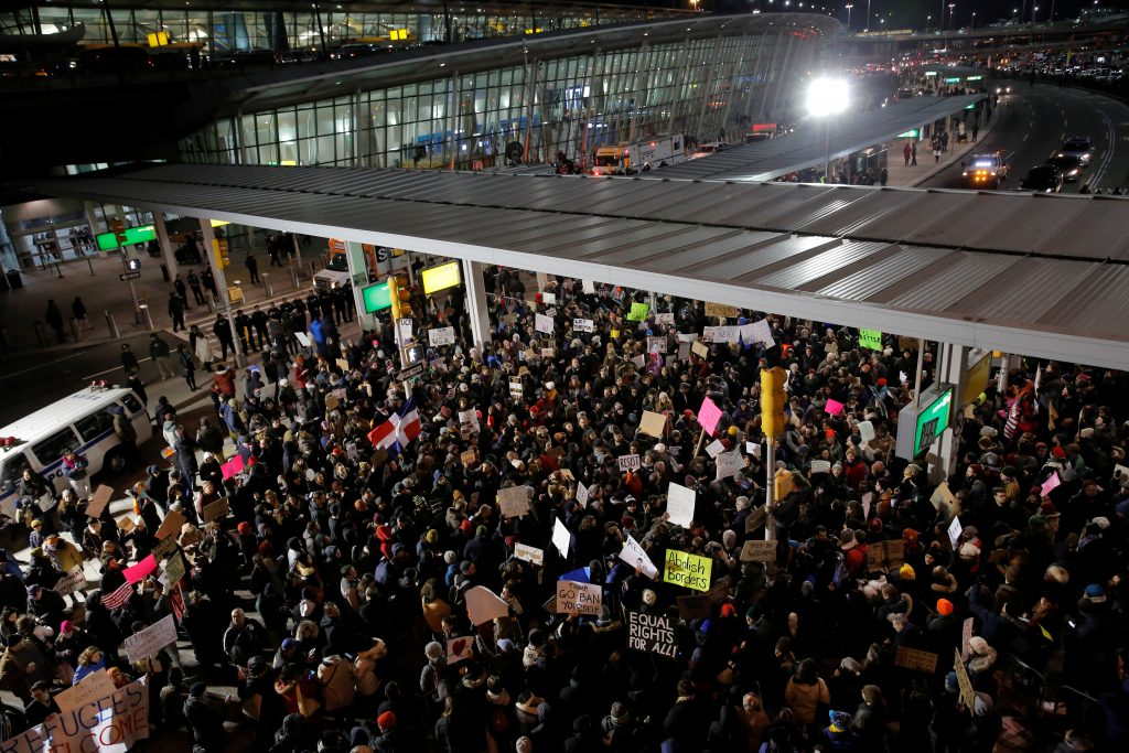 Protesters gather outside Terminal 4 at John F. Kennedy airport in New York on Jan. 28 in opposition to the executive order putting the visa-holder and refugee programs on hold. Photo by Stephen Yang/Reuters