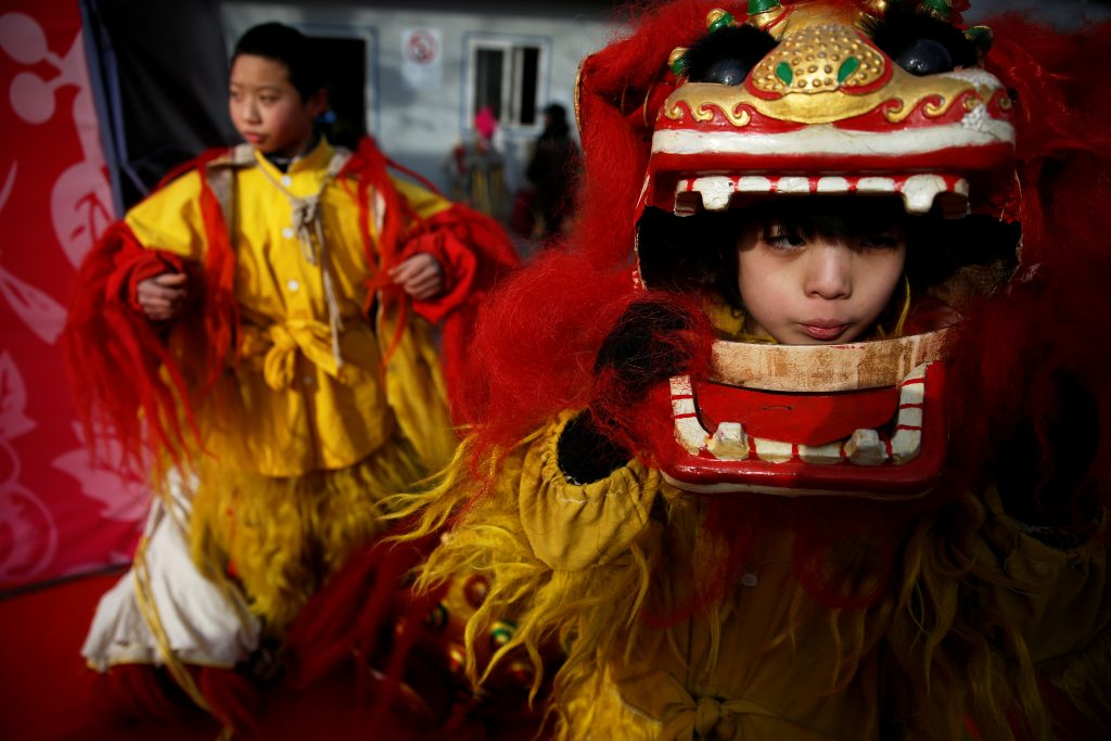 Young performers put their lion dance costumes as they go onto the stage at the Longtan park as the Chinese Lunar New Year, which welcomes the Year of the Rooster, is celebrated in Beijing, China January 29, 2017. Photo by: Damir Sagolj