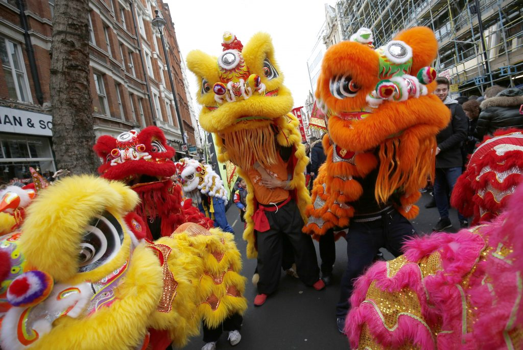 Participants wear costume as they take part in an event to celebrate the Chinese Lunar New Year of the Rooster in London, Britain, January 29, 2017. Photo by: Neil Hall