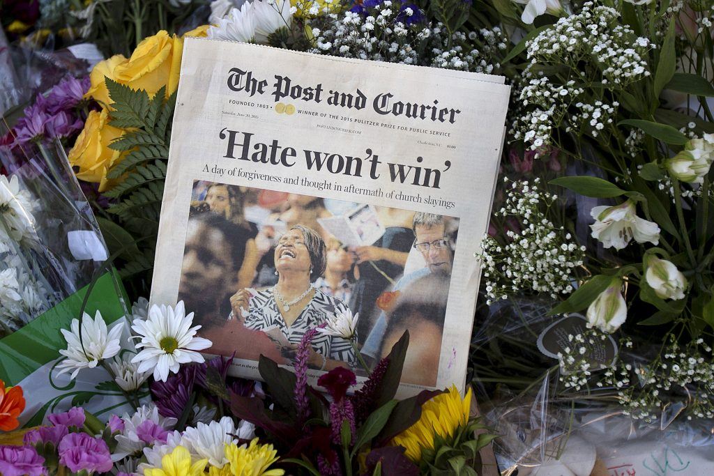 A newspaper left as a sign of support is pictured at a makeshift memorial at Emanuel African Methodist Episcopal Church in Charleston. Dylann Roof, a 21-year-old with a criminal record, faces sentencing after he was convicted of killing nine people at a Bible-study meeting in the historic African-American church in Charleston, South Carolina, in an attack U.S. officialsinvestigated as a hate crime. Photo by Carlo Allegri/Reuters