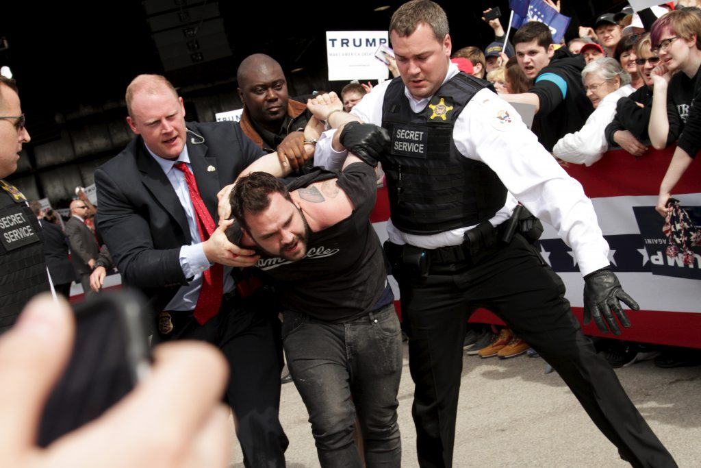 U.S. Secret Service agents detain a man at a Trump rally in Dayton, Ohio on March 12, 2016. Photo by William Philpott/REUTERS