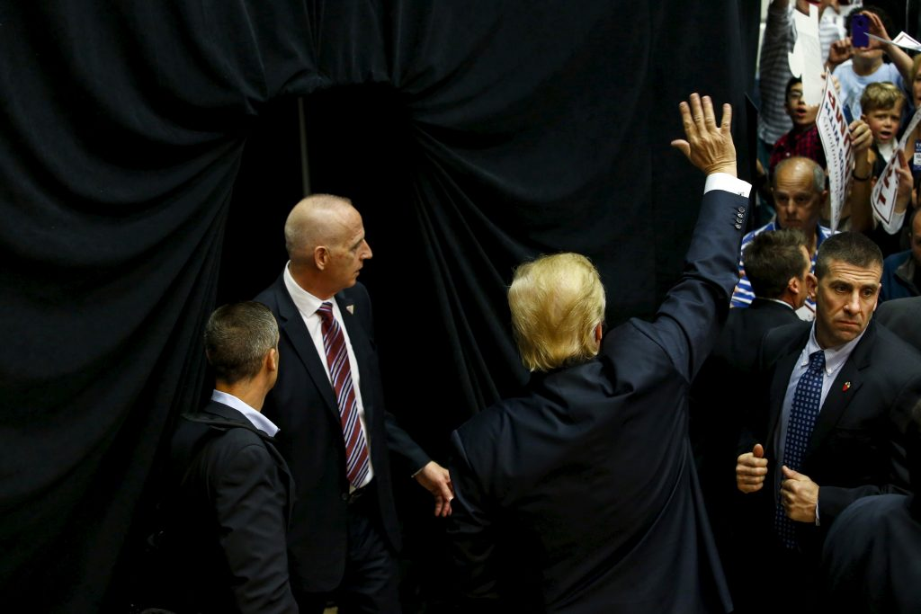 Trump waves to supporters as he is escorted by security members, including Schiller (center) after speaking at a campaign rally in Connecticut on April 23, 2016. Photo by Eduardo Munoz/REUTERS