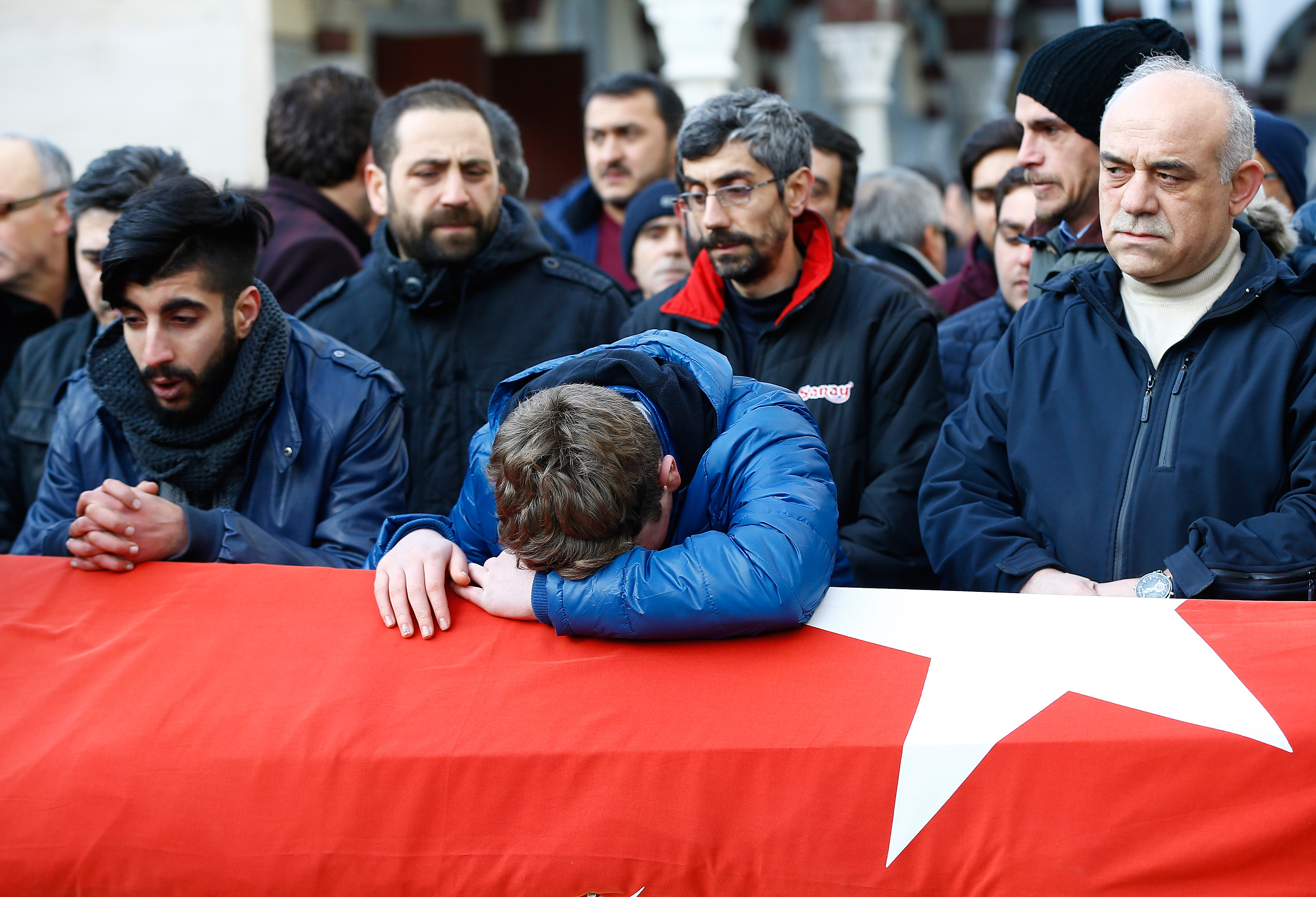 Relatives react at the funeral of Ayhan Arik, a victim of an attack by a gunman at Reina nightclub, in Istanbul, Turkey, January 1, 2017. Photo By Osman Orsal/Reuters
