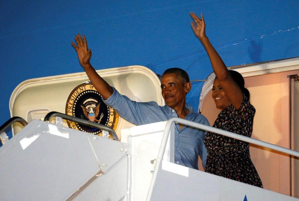 President Barack Obama and first lady Michelle Obama depart Joint Base Pearl Harbor-Hickam upon the conclusion of their vacation on Oahu in Hawaii. Photo by Kevin Lamarque/Reuters