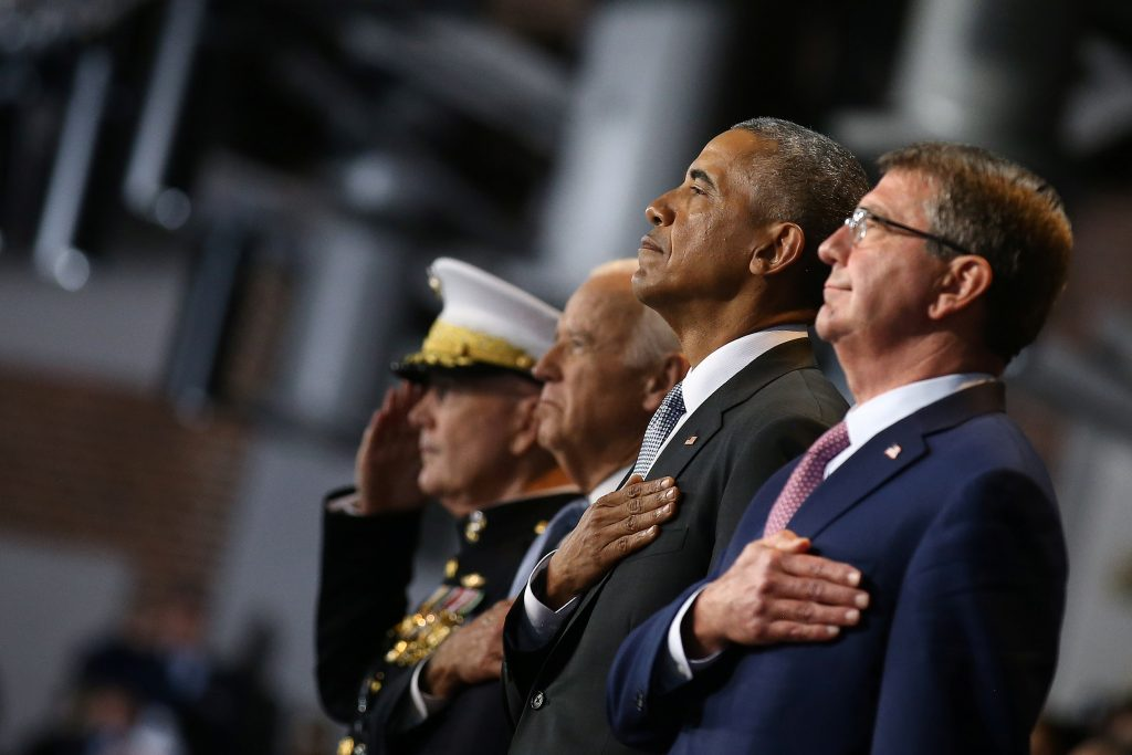 President Barack Obama attends a military full honor review farewell ceremony given in his honor, accompanied by Vice President Joe Biden, Joint Chiefs of Staff Chairman Gen. Joseph Dunford (L) and Defense Secretary Ash Carter (R) at Joint Base Myer-Henderson in Washington, D.C. Photo by Carlos Barria/Reuters