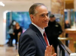 David Shulkin, Under Secretary of Health for the U.S. Department of Veterans Affairs, waves to a reporter after meeting in the lobby of Trump Tower in Manhattan, New York, U.S., January 9, 2017. REUTERS/Shannon Stapleton - RTX2Y845