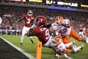 Alabama Crimson Tide running back Bo Scarbrough (9) scores on a 25 yard touchdown past Clemson Tigers defensive back Ryan Carter (31) and defensive lineman Christian Wilkins (42) in the 2017 College Football Playoff National Championship Game at Raymond James Stadium. Photo by Matthew Emmons-USA TODAY Sports