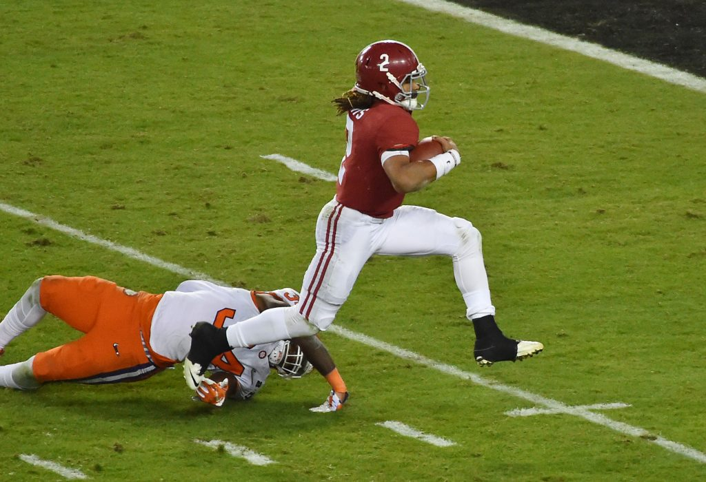Alabama Crimson Tide quarterback Jalen Hurts (2) scores a touchdown after getting past Clemson Tigers linebacker Kendall Joseph (34) in the fourth quarter in the 2017 College Football Playoff National Championship Game at Raymond James Stadium. Photo by Jasen Vinlove-USA TODAY Sports