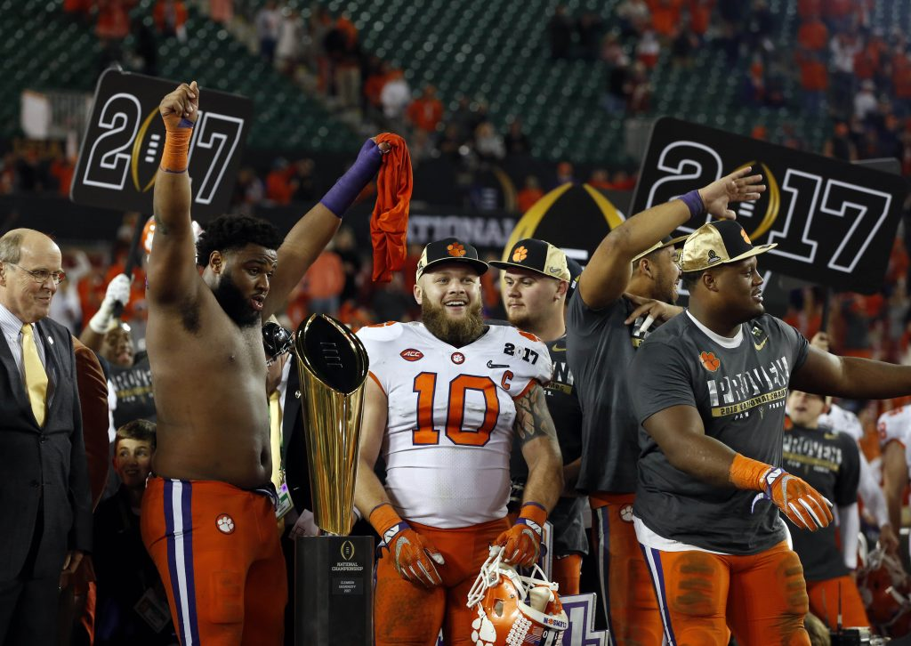 Clemson Tigers linebacker Ben Boulware (10) celebrates with teammates after defeating the Alabama Crimson Tide in the 2017 College Football Playoff National Championship Game at Raymond James Stadium. Photo by Kim Klement-USA TODAY Sports