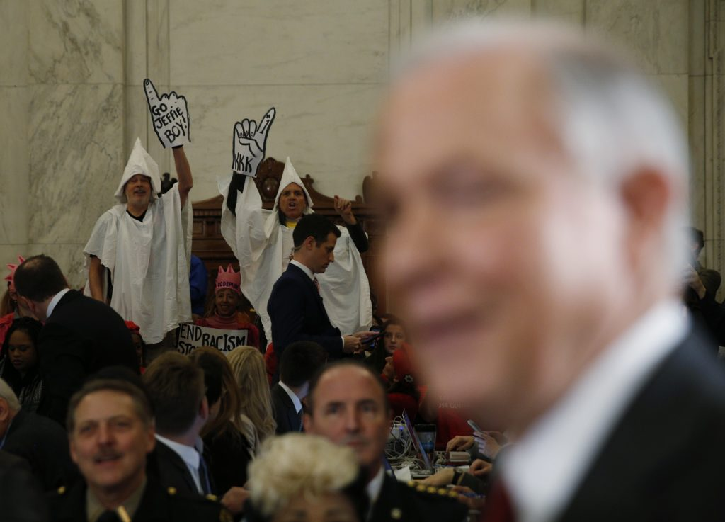 Protesters dressed as Klansmen disrupt the start of a Senate Judiciary Committee confirmation hearing for Attorney General-nominee Sen. Jeff Sessions (R) on Capitol Hill in Washington, D.C. Photo by Kevin Lamarque/Reuters