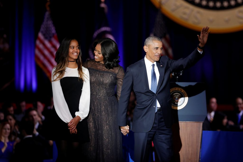 U.S. President Barack Obama his wife Michelle and their daughter Melia acknowledge the crowd after President Obama delivered a farewell address at McCormick Place in Chicago, Illinois, U.S. January 10, 2017. REUTERS/John Gress - RTX2YEQ0