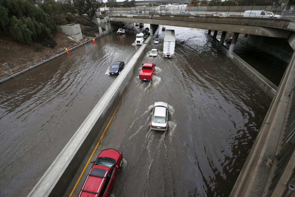 FILE PHOTO --  Vehicles drive on the flooded 5 freeway after an El Nino-strengthened storm brought rain to Los Angeles, California, United States, January 6, 2016. REUTERS/Lucy Nicholson/File Photo - RTX2YQHI