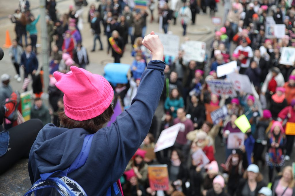 Marchers head down a side street during the women's march and rally in downtown D.C. on Saturday, January 21, 2017. Photo by Abbey Oldham.