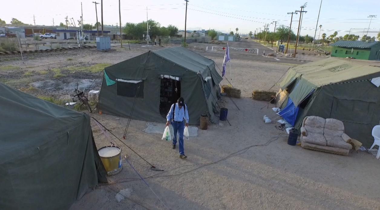 & Homeless veterans take refuge at Arizona encampment | PBS NewsHour