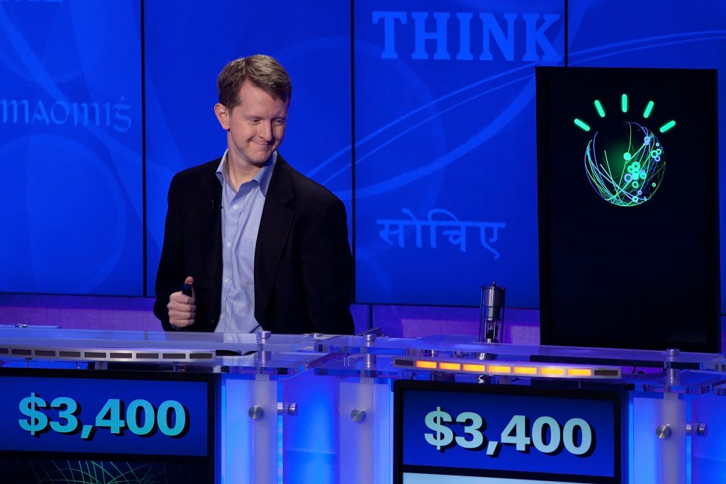 "Contestant Ken Jennings competes against 'Watson' at a press conference for the Man V. Machine ""Jeopardy!"" competition. Photo: Ben Hider/Getty Images"