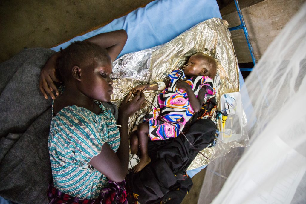 JUBA, SOUTH SUDAN - FEBRUARY 17: (EDITORIAL USE ONLY MANDATORY CREDIT / UNICEF HANDOUT/GONZALEZ FARRAN) A South Sudanese woman Sarah Nyawar receives treatment with her baby Nyamule Thuokhok at the UN Protection of Civilians (PoC) site in Juba, South Sudan on February 17, 2017. Due to the malnutrition, lack of food, continuing clashes and poverty, South Sudanese people, especially babies live in hard conditions. (Photo by Handout/UNICEF/Gonzalez Farran/Anadolu Agency/Getty Images)