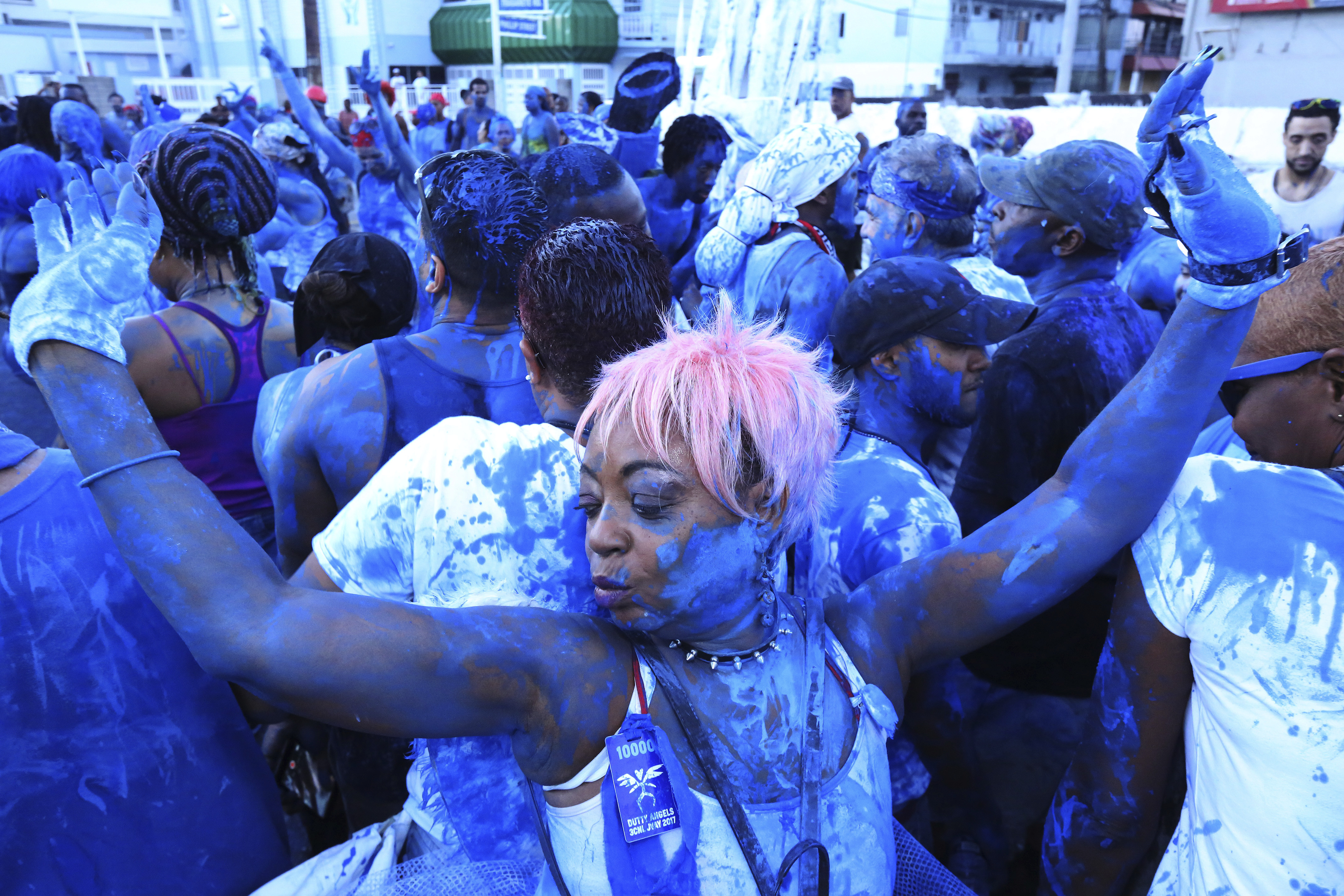PORT OF SPAIN, TRINIDAD - FEBRUARY 27: J'ouvert revellers covered in blue paint dance and parade with the Rapso music band 3canal during the 20th anniversary celebration of their song Blue as part of Trinidad Carnival on February 27, 2017 in Port of Spain, Trinidad. (Photo by Sean Drakes/LatinContent/Getty Images)