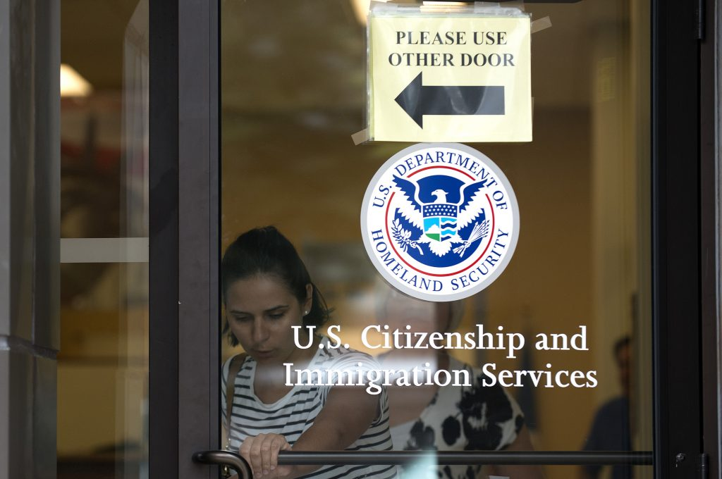 A woman leaves the U.S. Citizenship and Immigration Services office in New York on Aug. 15, 2012. File Photo by Keith Bedford/Reuters