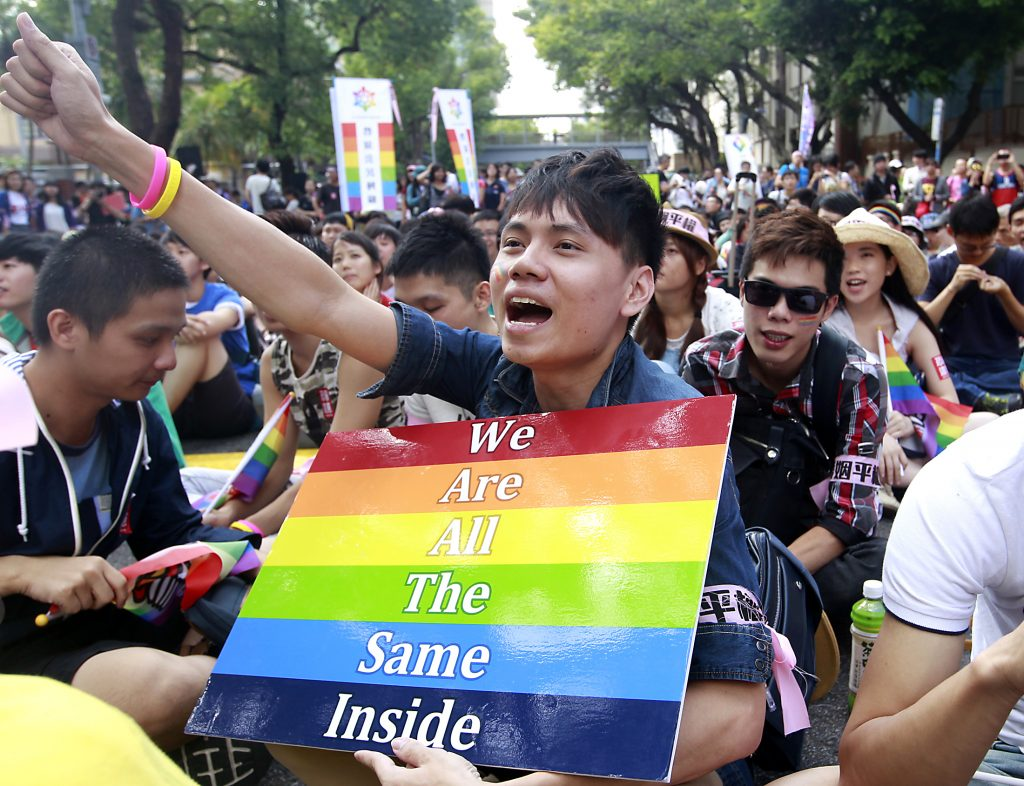 A protester shouts slogans during a rally to urge Taiwan's parliament to consider a bill that could legalize same-sex marriage outside the Legislative Yuan in Taipei October 5, 2014. REUTERS/Pichi Chuang (TAIWAN - Tags: POLITICS CIVIL UNREST) - RTR48YR6