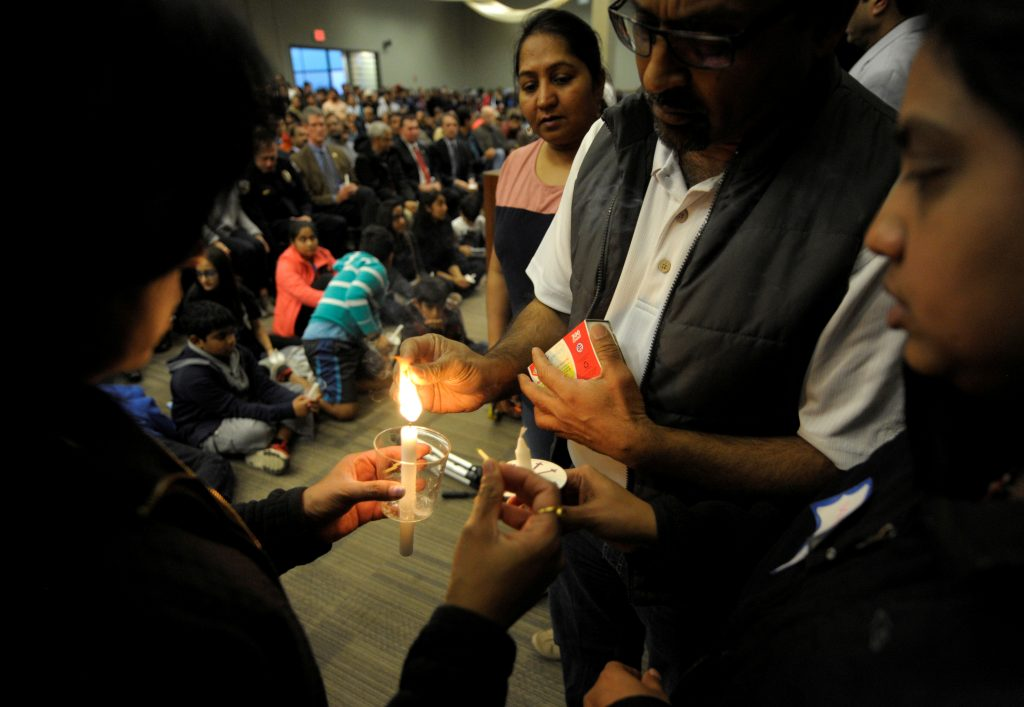 Organizers light the first candle during a Feb. 26 vigil for Srinivas Kuchibhotla, an Indian engineer who was shot and killed, at a conference center in Olathe, Kansas. Photo by Dave Kaup/Reuters
