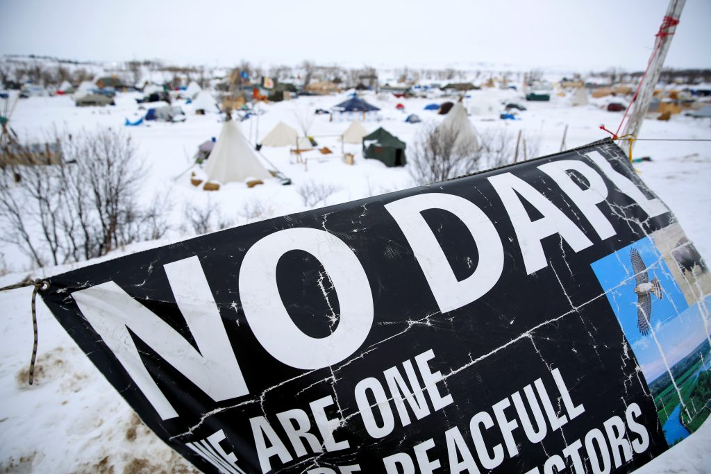 A banner flies in the Dakota Access Pipeline protest camp near Cannon Ball, North Dakota. Photo by Terray Sylvester/Reuters