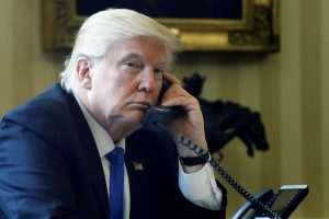 President Donald Trump speaks by phone with Russia's President Vladimir Putin in the Oval Office at the White House in Washington, D.C. in January. Photo By Jonathan Ernst/Reuters