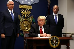 U.S. President Donald Trump signs an executive order to impose tighter vetting of travelers entering the United States, at the Pentagon in Washington, U.S., January 27, 2017. The executive order signed by Trump imposes a four-month travel ban on refugees entering the United States and a 90-day hold on travelers from Syria, Iran and five other Muslim-majority countries. Picture taken January 27, 2017. Photo By Carlos Barria/Reuters