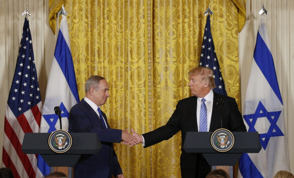 U.S. President Donald Trump (R) greets Israeli Prime Minister Benjamin Netanyahu after a joint news conference Feb. 15 at the White House in Washington, D.C. Photo by REUTERS/Kevin Lamarque  - RTSYUDS