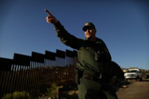 A U.S. border patrol agent walks along the U.S. border with Mexico in Nogales, Arizona, on Jan. 31, 2017. Photo by Lucy Nicholson/Reuters