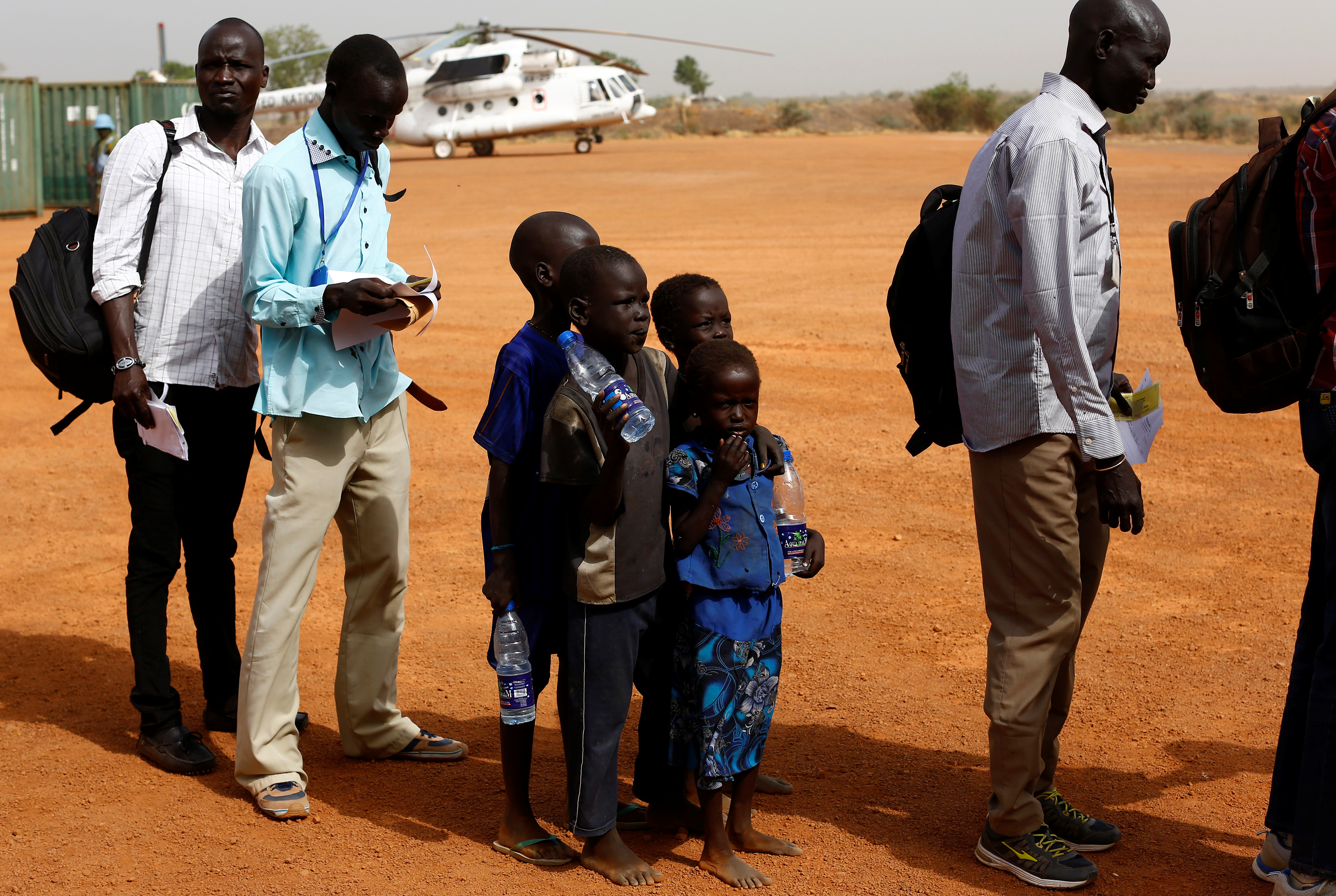 Four children wait to board a U.N. flight to Juba, where they will be reunited with their mother. Photo by Siegfried Modola/Reuters