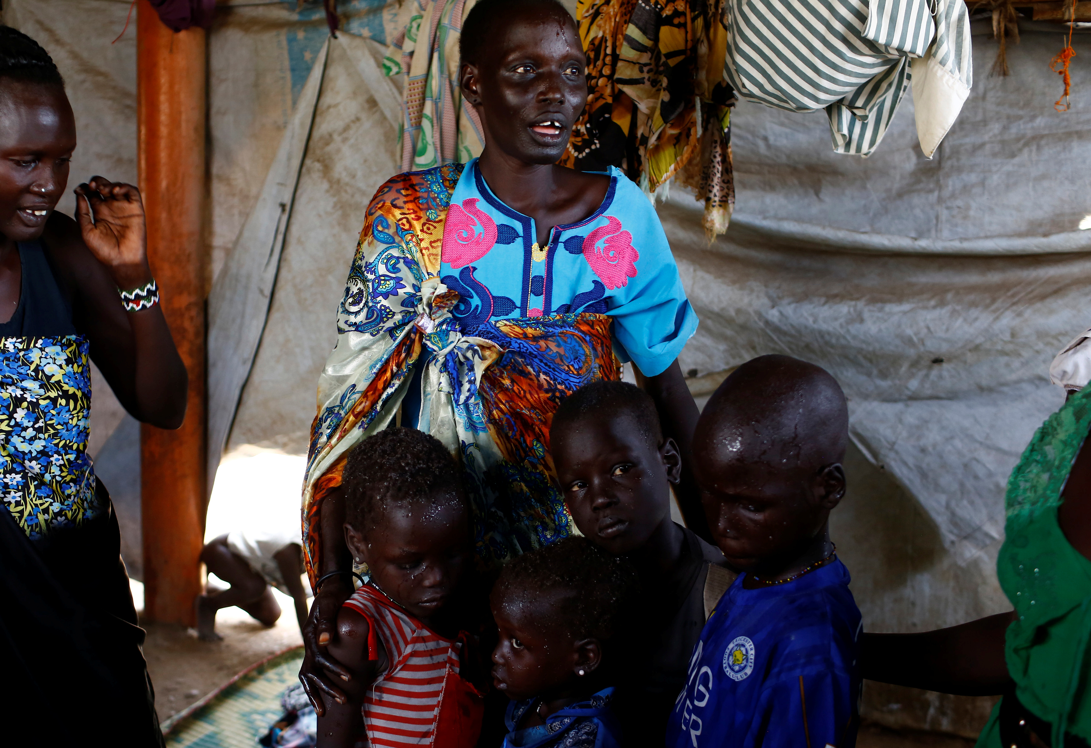 Nyagonga Machul, 38, embraces her children (from left to right) Nyameer Mario, 6, Nyawan Mario, 4, Ruai Mario, 10, and Machiey Mario, 8, in Juba, South Sudan, on Feb. 13. Photo by Siegfried Modola/Reuters