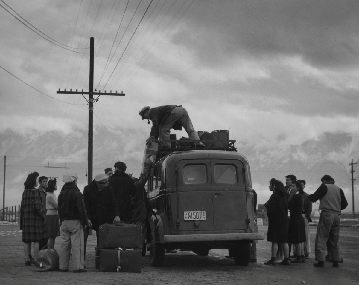 People are loading a bus for relocation heading to the Manzanar War Relocation Center in California, in this 1943 handout photo. February 19, 2017 marks the 75th anniversary of FDR signing executive order 9066, authorizing the internment of Japanese Americans during the Second World War. Courtesy Ansel Adams/Library of Congress, Prints and Photographs Division, LC-A35-4-M-10/Handout via REUTERS ATTENTION EDITORS - THIS IMAGE WAS PROVIDED BY A THIRD PARTY. EDITORIAL USE ONLY. - RTSZ5NF