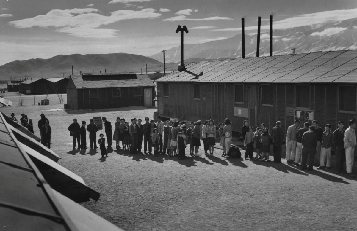 A mess line is formed in front of a building at midday at the Manzanar War Relocation Center in California, in this 1943 handout photo. February 19, 2017 marks the 75th anniversary of FDR signing executive order 9066, authorizing the internment of Japanese Americans during the Second World War. Courtesy Ansel Adams/Library of Congress, Prints and Photographs Division, LC-A35-4-M-10/Handout via REUTERS ATTENTION EDITORS - THIS IMAGE WAS PROVIDED BY A THIRD PARTY. EDITORIAL USE ONLY. - RTSZ5NL