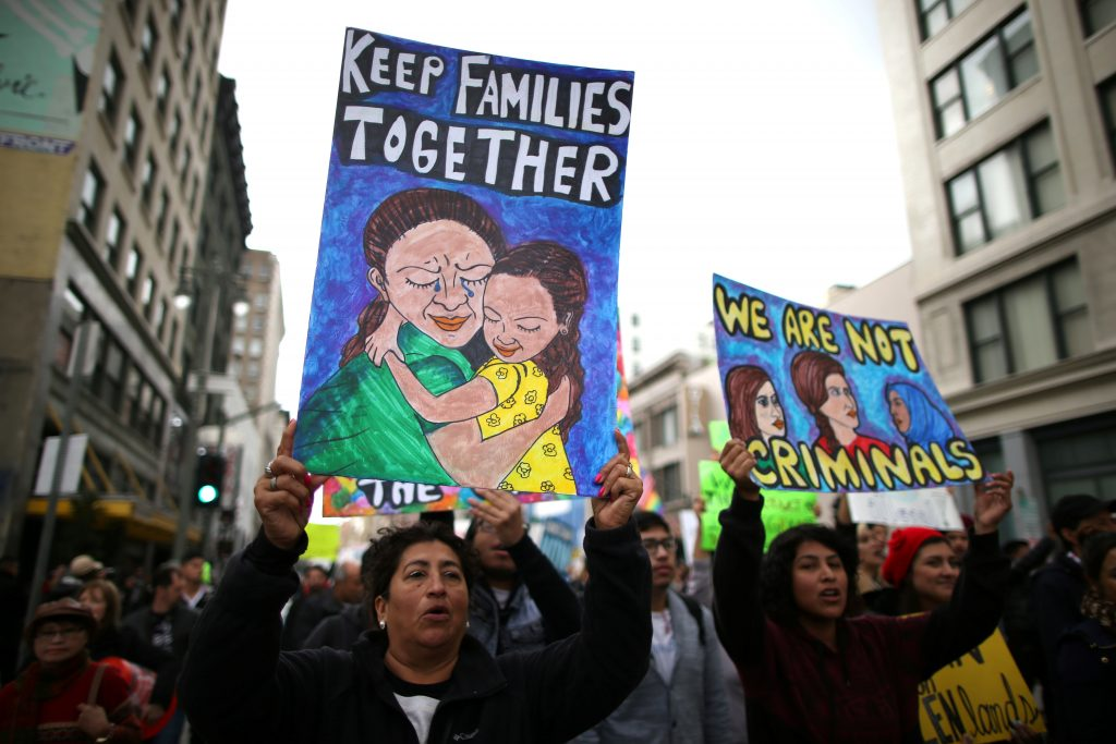 People participate in a protest march calling for human rights and dignity for immigrants, in Los Angeles. Photo by Lucy Nicholson/Reuters