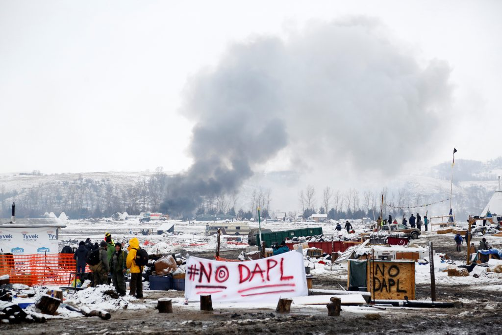 A fire burns in main opposition camp against the Dakota Access oil pipeline near Cannon Ball