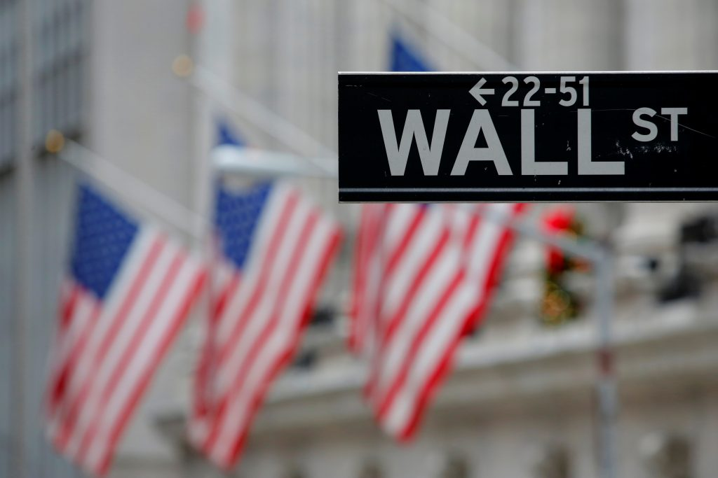 A street sign for Wall Street is seen outside the New York Stock Exchange (NYSE) in Manhattan, New York City. Photo by Andrew Kelly/Reuters