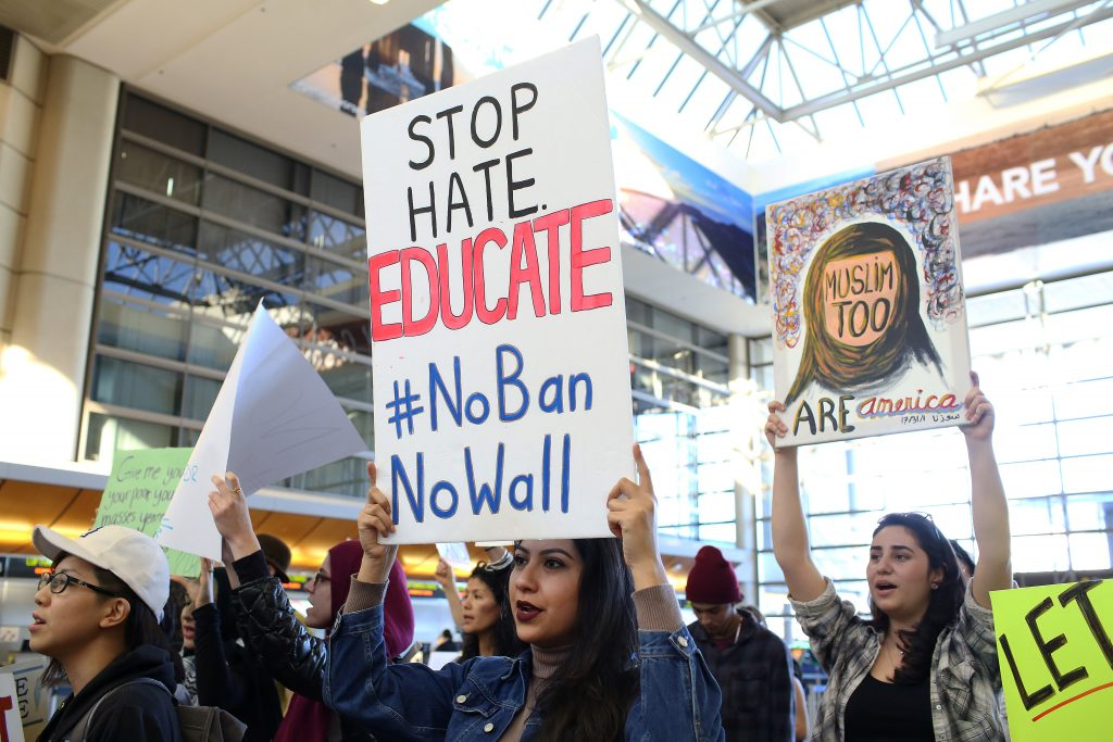 Protesters against President Donald Trump's travel ban voiced support for immigrants and refugees at Los Angeles International Airport on Jan. 31. Photo by Monica Almeida/Reuters