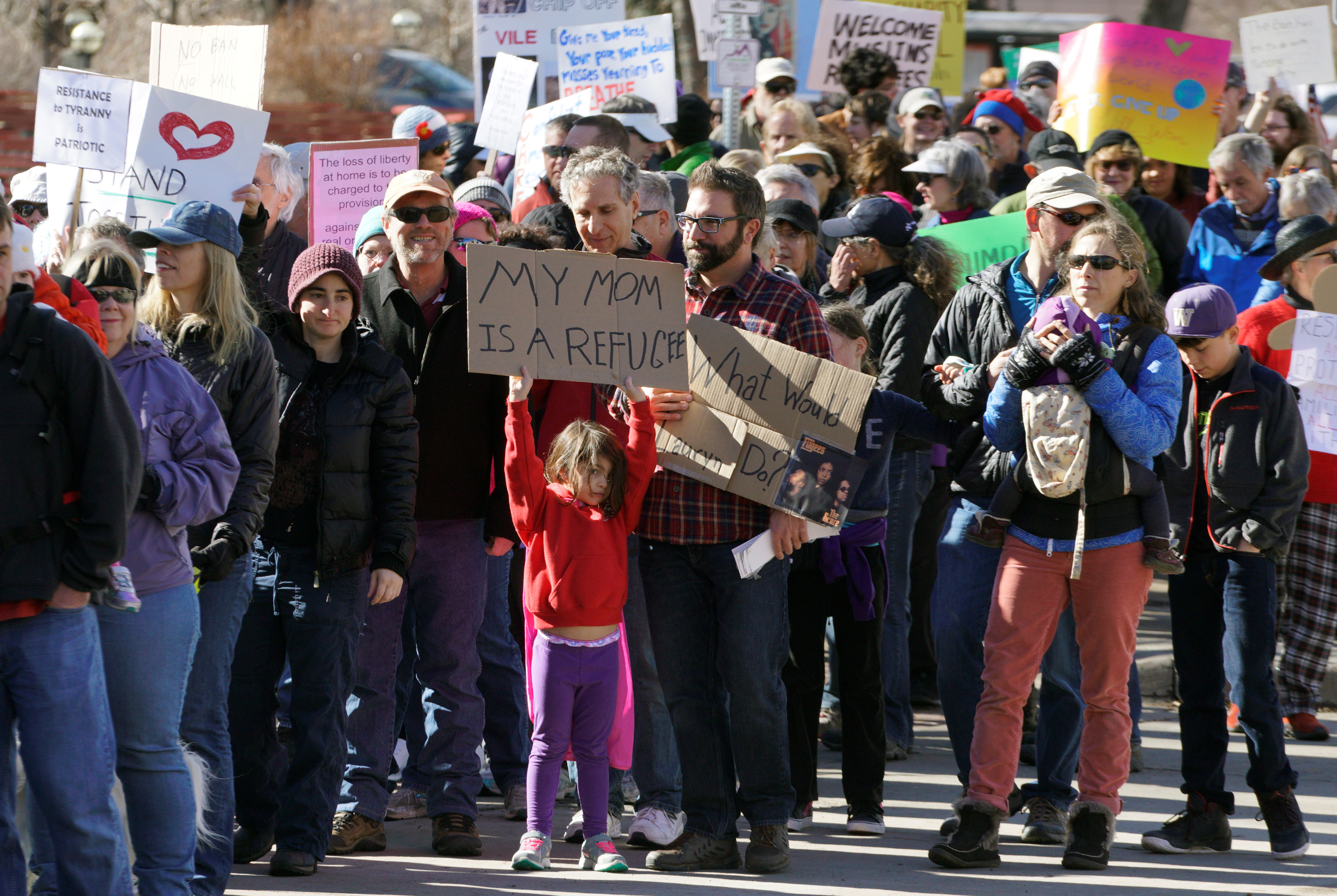 People march to voice their disapproval of U.S. President Donald Trump's policies downtown Boulder, Colorado, U.S. February 4, 2017. REUTERS/Rick Wilking - RTX2ZN0S