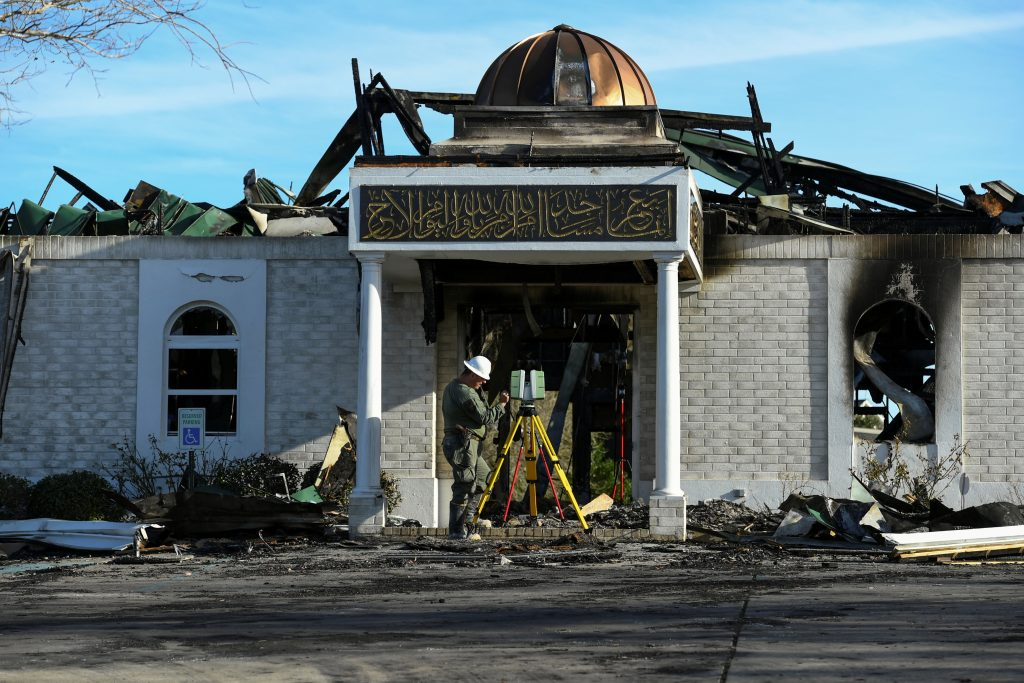 A security official investigates the aftermath of a fire at the Victoria Islamic Center mosque in Victoria, Texas, on Jan. 29. Photo by Mohammad Khursheed/Reuters