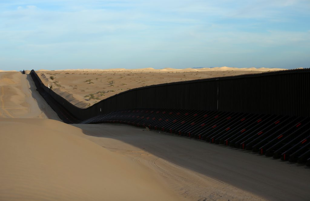 The barrier between Mexico and the U.S. is a series of walls and fences, along with natural barriers of rivers and cliffs. Photo by Mike Blake/Reuters