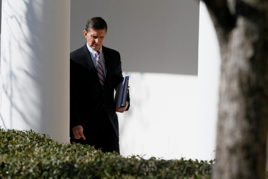 White House National Security Advisor Michael Flynn walks down the White House colonnade on the way to Japanese Prime Minister Shinzo Abe and U.S. President Donald Trump's joint news conference at the White House in Washington, U.S., February 10, 2017. REUTERS/Jim Bourg - RTX30IOV