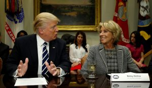 President Donald Trump talks to Secretary of Education Betsy DeVos during a meeting with teachers and parents Feb.14 at the White House in Washington, D.C. Photo by Kevin Lamarque/Reuters