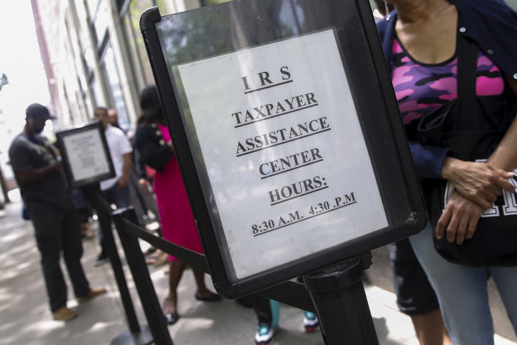 People wait outside the Internal Revenue Service office in the Brooklyn borough of New York in 2015. Photo by Shannon Stapleton/Reuters
