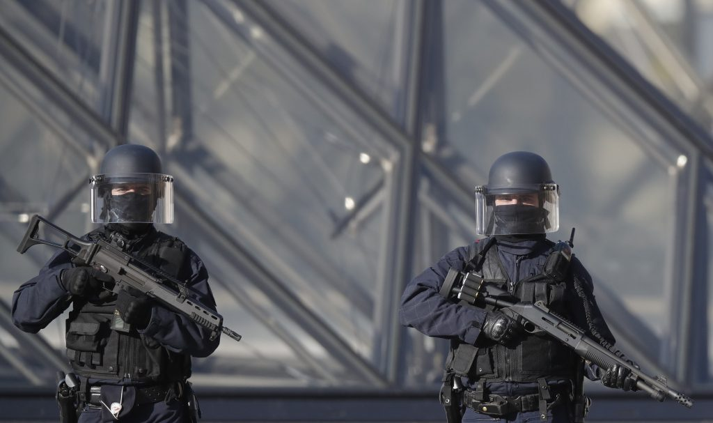 French police secure the area Feb. 3 near the Louvre Pyramid in Paris, France after a French soldier shot and wounded a man armed with a machete as he tried to enter the Paris Louvre museum. Photo by REUTERS/Christian Hartmann.