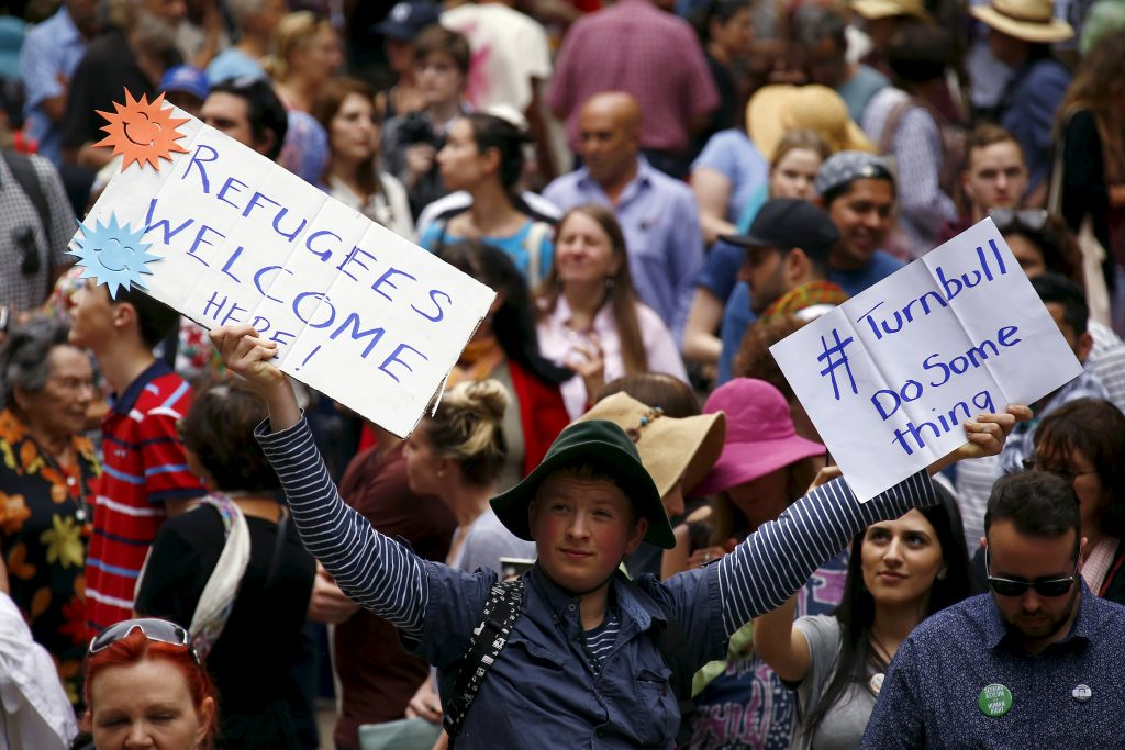 Demonstrators hold aloft placards during a 2015 rally in support of refugees that was part of a national campaign in central Sydney, Australia. Photo by REUTERS/David Gray.
