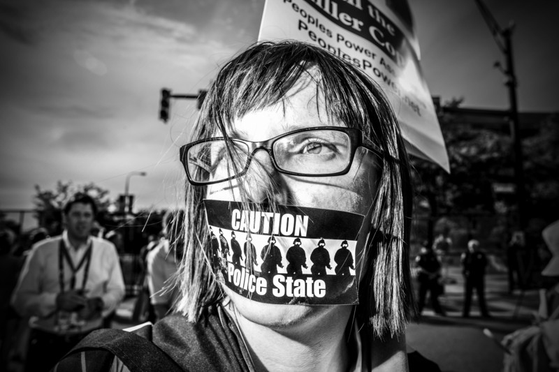 A Shut Down Trump protester at the 2016 Republican National Convention in July 2016 marched thru the streets of Cleveland, Ohio. Credit: Mark Peterson/Redux